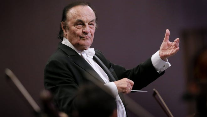 Swiss conductor Charles Dutoit directs the Royal Philharmonic Orchestra at Grand Palace Concert Hall in Bucharest, Romania, Sept. 12, 2017