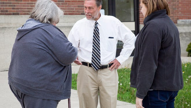 Democratic Congressional candidate Bruce Peavler iof Yorktown campaigns the Fieldhouse on Tuesday.