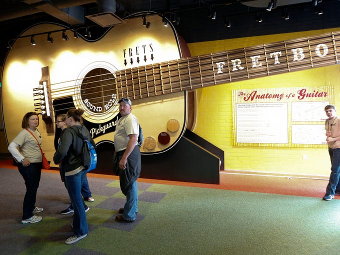 In this April 10, 2014, photo, a 52-foot replica of an acoustic guitar is seen in a new section of the Country Music Hall of Fame and Museum in Nashville, Tenn. Educational exhibits are part of the $100 million expansion. (AP Photo/Mark Humphrey)