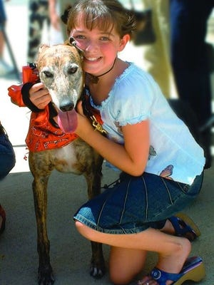Karle Warren hugs a greyhound rescued from the racing industry. The Humane Society's upcoming breakfast workshop will help voters learn how to help greyhounds, pets and wildlife.