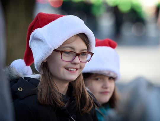 Hundreds lined the edge of Cumberland to watch a kick off of the holiday season, including those really in the spirit of Christmas donning Santa hats.