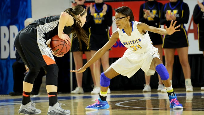 Westview's Titi Vincent guards an Elizabethton player during their TSSAA Class AA quarterfinal game, Friday. Westview leads Elizabethton 16-7.