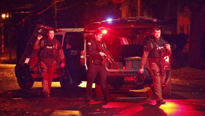 Elmira Police leave the scene of a shooting Thursday after clearing a house on the 300 block of Fulton Street on Elmira's Southside.
