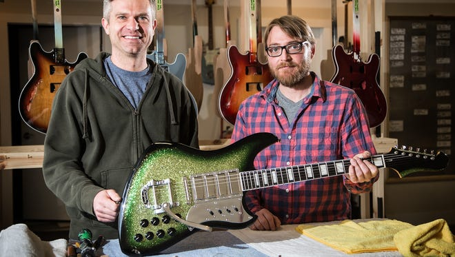 Tim Thelen and Bill Henss of BilT Guitars hold guitar they're making for Ryan Adams in their Des Moines shop Tuesday, March 29, 2016.