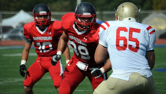 Jake Metz, center, is the all-time leader in sacks at Shippensburg University, and on Monday, he signed a contract with the Philadelphia Eagles.