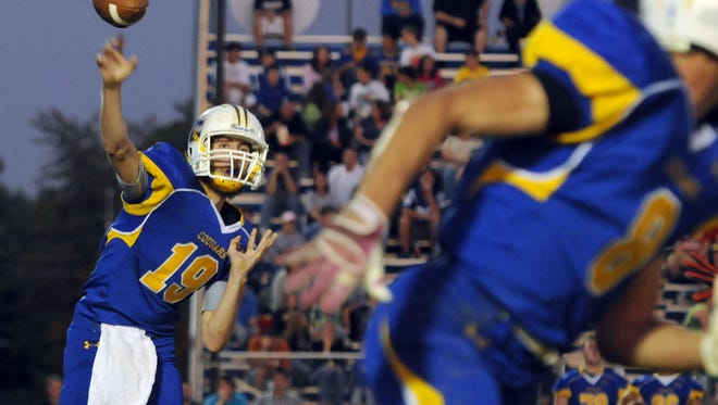 Greenfield-Central High School's Tyler Colclazier fires a screen pass out to the right-side receiver, Matt Dickerson in the first half of action. Greenfield-Central High School hosted New Palestine High School in varsity football action Friday, October 7, 2011.