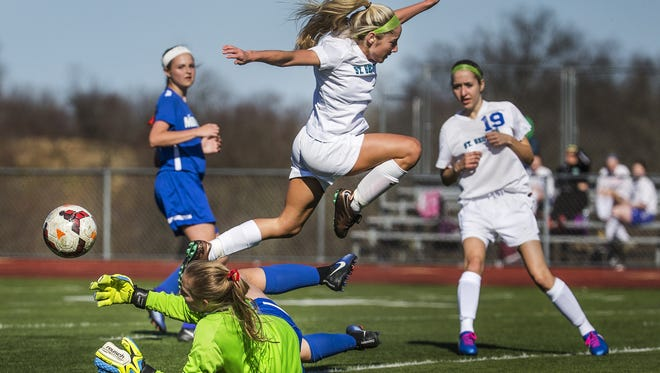 St. Georges' Daniella DeSouza leaps over Middletown keeper Taylor Wolf in the first half of Middletown's 4-0 win last Wednesday.