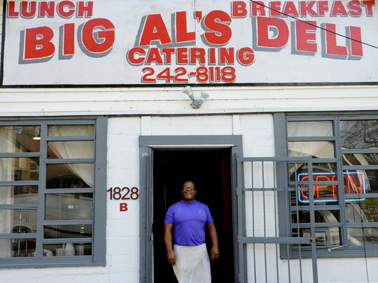 Al Anderson stands in the door of his restaurant on