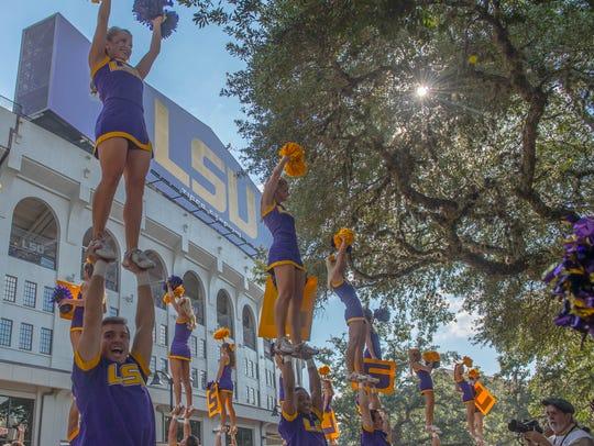 LSU cheerleaders cheer on the fans ahead of the Tigers'