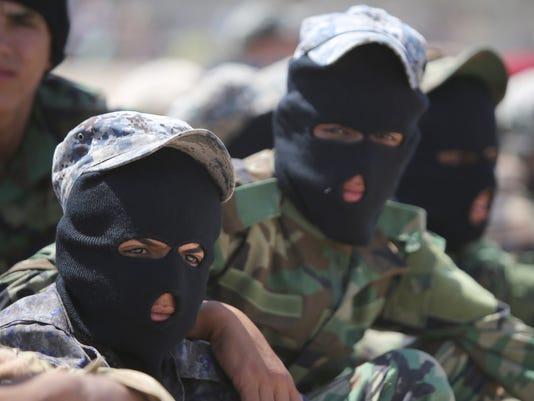 50 bodies found in Iraq, raising sectarian worries
