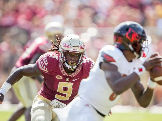 Florida State defensive end Josh Sweat (9).