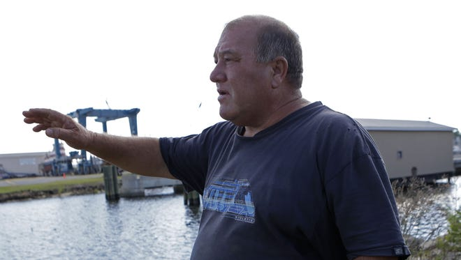 In this Oct. 9, 2013 file photo, Calvin Parker, Jr., stands in the area where he and fellow Mississippian Charles Hickson were allegedly abducted by aliens on Oct. 11, 1973, on the banks of the Pascagoula River in Pascagoula Miss. The incident made headlines, sparked UFO sightings nationwide and became one of the most widely examined cases on record.