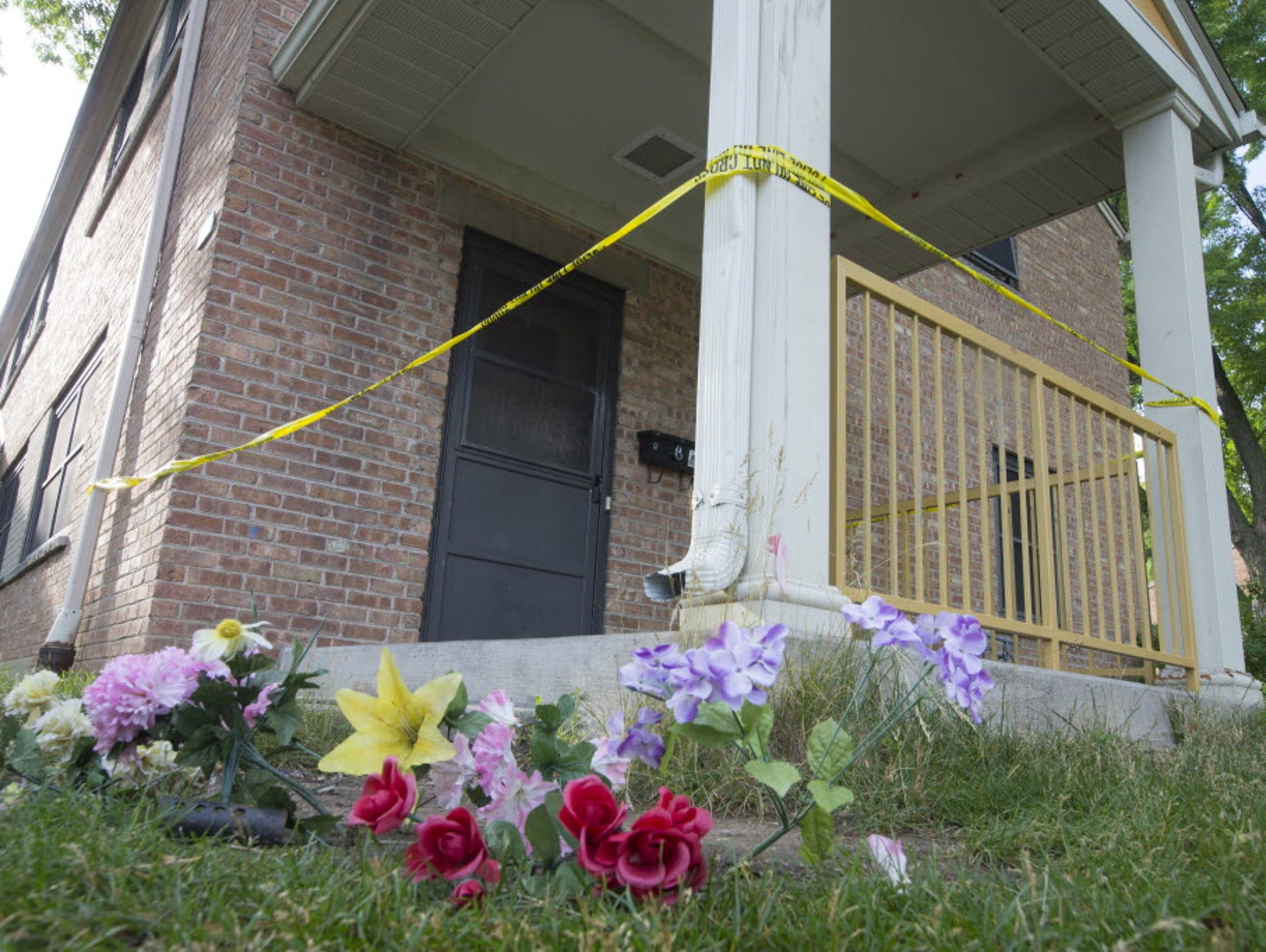 Police tape marks the scene where 13-year-old Giovonnie