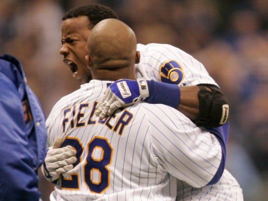 Milwaukee Brewers second baseman Rickie Weeks is hoisted