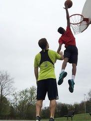 Rich Brown and Kadir Penn play basketball together.