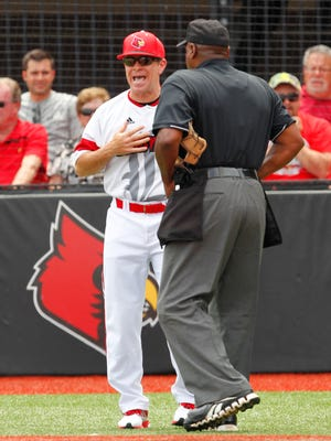 University of Louisville head coach Dan McDonnell questions a call by the umpire during their game against Florida State at Patterson Stadium in Louisville, Kentucky.       May 9, 2015