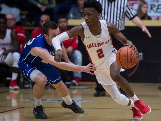 Bosse's Mekhi Lairy (2) drives past Memorial's Andrew