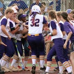 ASH junior Carrie Boswell (#32) is mobbed at home plate following her homerun against the Live Oak Lady Eagles.