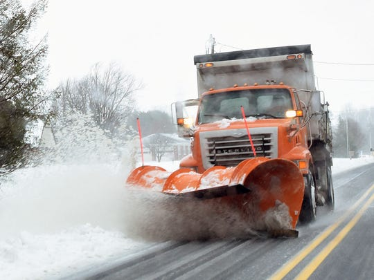 A DelDOT snow plow working its way south on Rt. 15 in Milford.