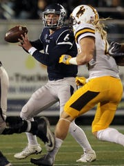Wolf Pack quarterback Ty Gangi sets to throw during