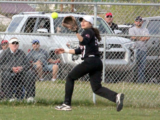 Jessica Martinez chases this ball down during action Tuesday against Silver. She is the Cobre centerfielder.