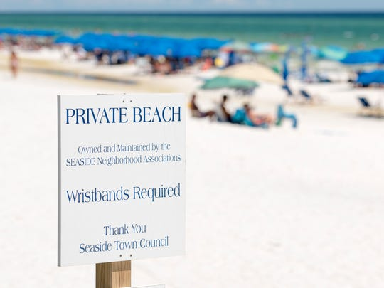 "A sign posted by the Seaside Neighborhood Associations and Seaside Town Council claims this stretch of sand as a ""Private Beach"" in Walton County, Florida on Wednesday, July 19, 2017."