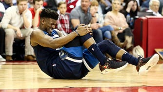 Jimmy Butler had to be carried off the court after suffering an apparent knee injury.