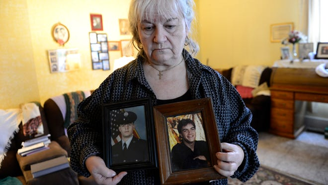 Lois Waggoner, 73, of Fremont holds photos of her two sons who died, contributing to her suicidal thoughts.