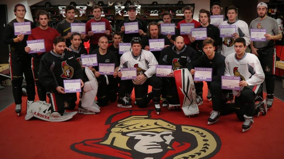 "The Ottawa Senators are hosting Hockey Fights Cancer night on Wednesday. Shane Prince (front row, far right) wrote the name ""Patrick Carr"" on his ""I Fight For"" placard."
