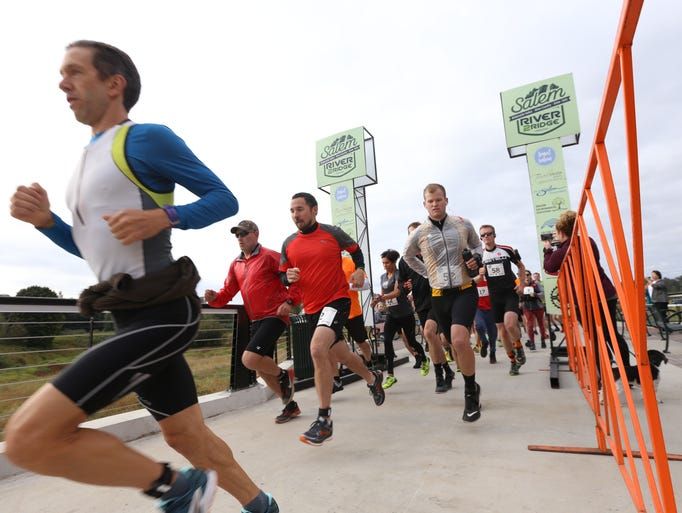 Runners cross the Peter Courtney Minto Island Bicycle
