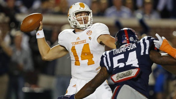 Tennessee quarterback Justin Worley is pressured by Ole Miss defensive end Carlos Thompson on Saturday at Oxford, Miss.