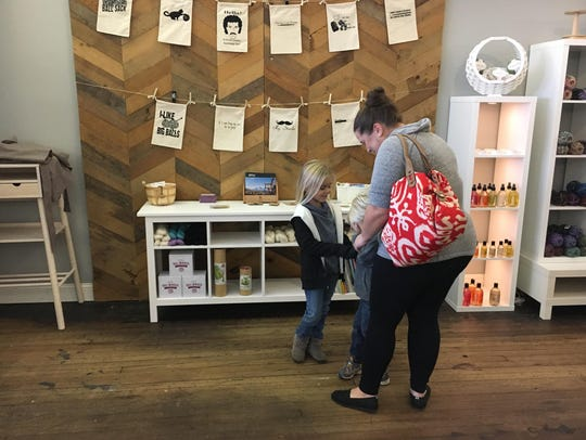 Shoppers explore Yarn Stories in downtown Muncie during