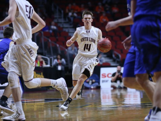 North Linn's Jake Hilmer brings the ball down the court