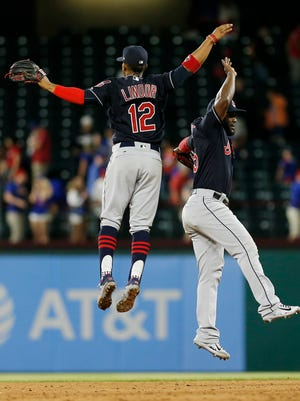 Cleveland Indians shortstop Francisco Lindor (12) and right fielder Abraham Almonte celebrate a 4-3 win over the Texas Rangers after a baseball game Tuesday, April 4, 2017, in Arlington, Texas. (AP Photo/Brandon Wade)