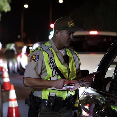 Authorities screen vehicles during a DUI and driver's