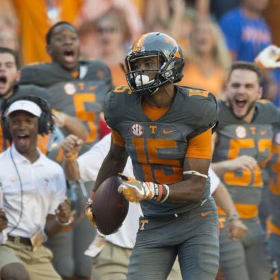 Tennessee wide receiver Jauan Jennings (15) is cheered on by the Tennessee sideline as scores a touchdown against Florida in the second half of the game on Saturday, September 24, 2016.