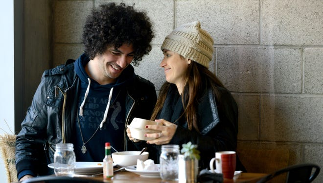 Nazim Chambi and Kristina Lehr enjoy a late lunch and each other's company on Monday at Harvest Café in Ventura.