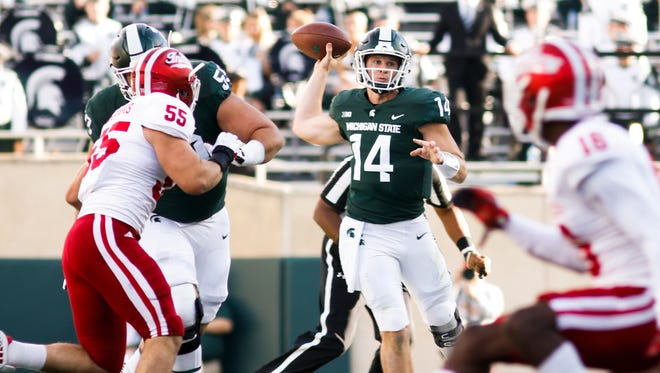 Michigan State quarterback Brian Lewerke completed 5-for-6 passes for 73 yards in Saturday's fourth quarter, along with the go-ahead touchdown toss in the Spartans' 17-9 win over Indiana.