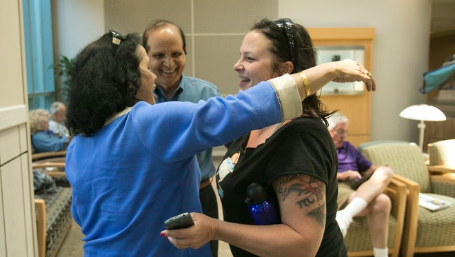 Kidney recipient Anu Dwivedi (left) and her husband, Ram, greet donor Amy Donohue at Mayo Clinic Hospital in Phoenix in April 2013.