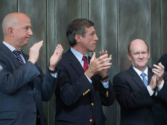 Gov. Jack Markell (from left), Rep. John Carney and Sen. Chris Coons applaud the announcement that JPMorgan Chase & Co. will add 1,800 Delaware jobs by 2019 during an event on Oct. 26. Carney is part of a group of Delaware Democrats who have shaped state government over the past three decades.