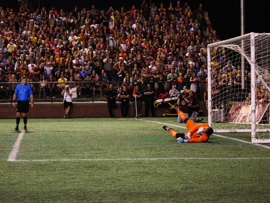 Detroit City FC goalie Fernando Pina lets in a goal