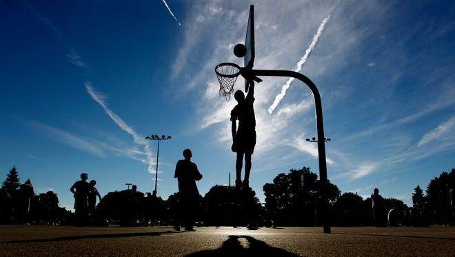 A player goes up for a layup during a game at Meaux Park in Milwaukee. Team GoGo won.
