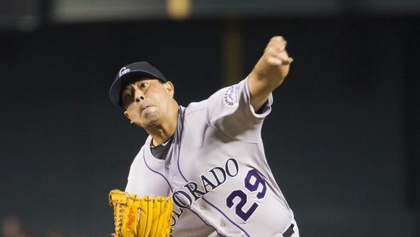 Colorado Rockies pitcher Jorge De La Rosa throws against
