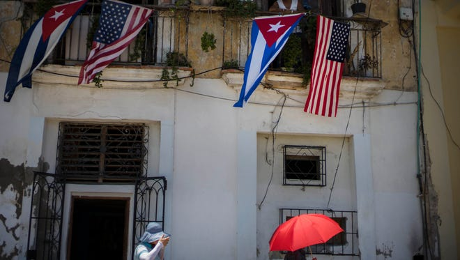 Cuban and U.S. flags hang from a resident's balcony on the day the U.S. opened its embassy in Havana on Aug. 14, 2015.