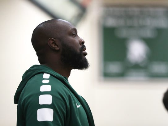 Lincoln Head Coach Rod Mack watches as his team team