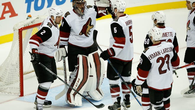 The Coyotes congratulate Mike Smith after Arizona's 3-0 win over the Ducks on Oct. 14, 2015 in Anaheim.