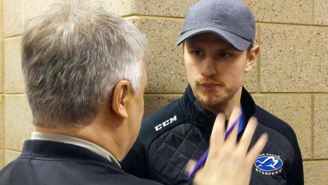 Nick Oliver is interviewed by Times reporter Mick Hatten before the NCAA Division I West Regional men's hockey tournament in Sioux Falls, South Dakota. Oliver, an assistant coach for the last three seasons for the Sioux Falls Stampede, has been named an assistant coach for the Huskies.