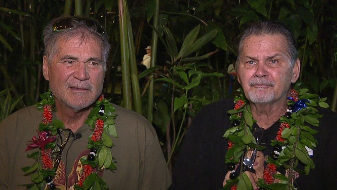 In this Dec. 23, 2017, image made from a video provided by Honolulu news station KHON, Alan Robinson and Walter Macfarlane are interviewed in Honolulu. The two Hawaii men grew up as best friends and recently learned that they're actually brothers. They revealed the surprise to family and friends over the holidays. The two, who have been friends for 60 years, were born in Hawaii 15 months apart and met in the sixth grade.