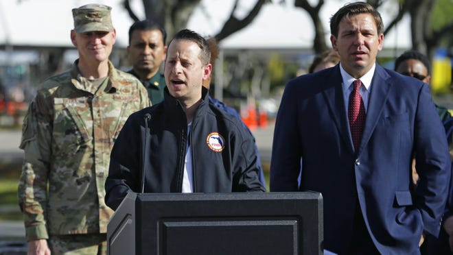 Director of Florida's Division of Emergency Management Jared Moskowitz alongside Florida Gov. Ron DeSantis talks to media during press conference at the Broward County mobile testing at CB Smith Park in Pembroke Pines last month.