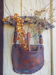 The traditional weed pocket hanging on cholla, bead